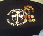 This shirt was found on Uncle Mikes bed with all of his service pins on it.