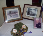 photos and hat with pins