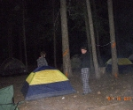 Tents and kids in a dark dark forest