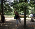 Mom throwing horse shoes